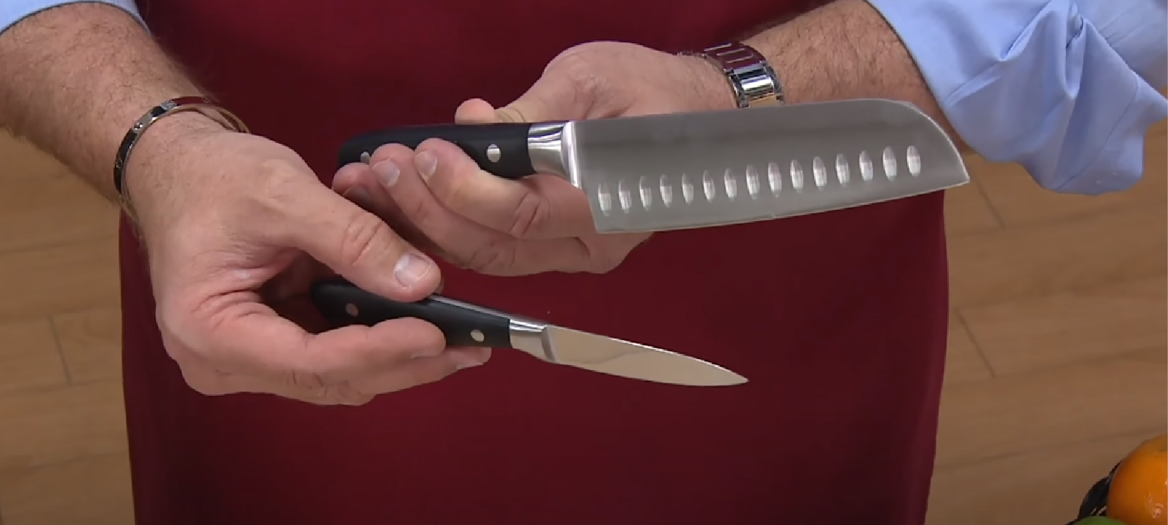 a chef holding the Farberware knives set
