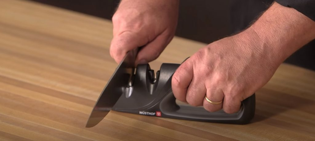a chef sharpening his knife