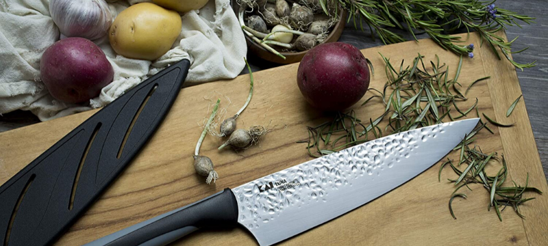stainless steel knife placed on cutting board