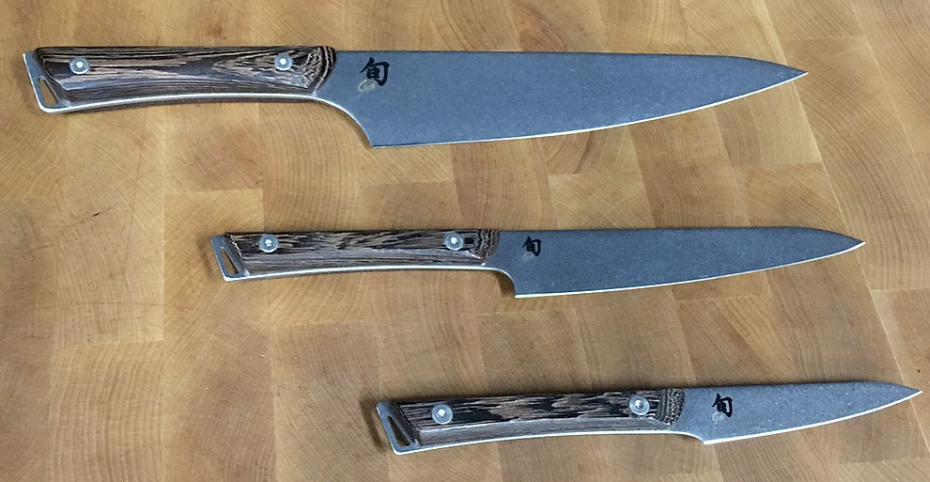 the three sizes of Shun knives on wooden board