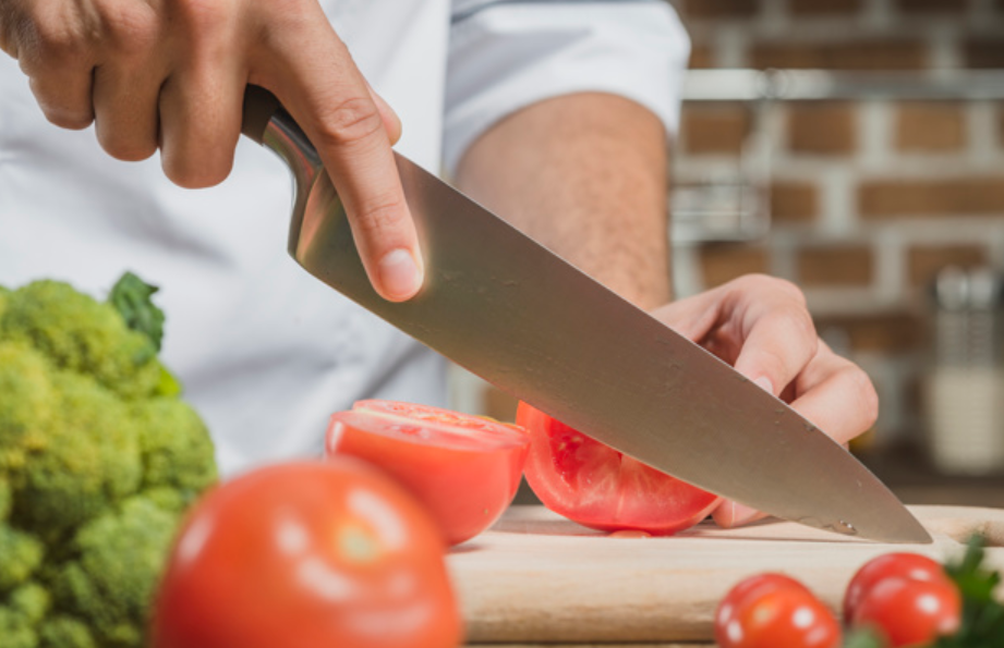 closeup view of knife in chef hand