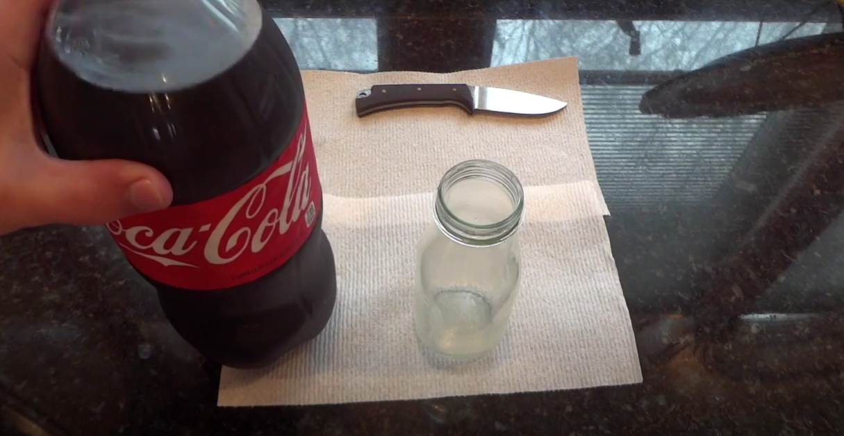 Knife and coke placed on table