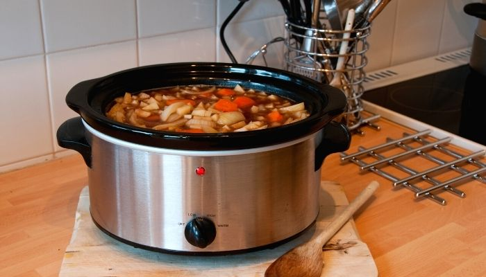 a slow cooker on a table